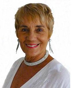 Marita Mason is a spiritual healer based in Noosa Queensland Australia wearing white